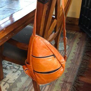 Orange leather sling bag or purse